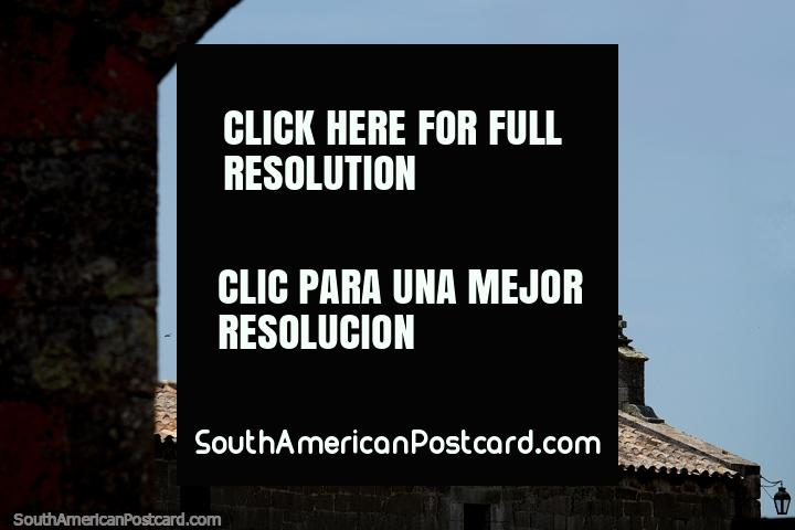 Church and lantern, red tiled roof at Santa Teresa Fort in Punta del Diablo. (720x480px). Uruguay, South America.