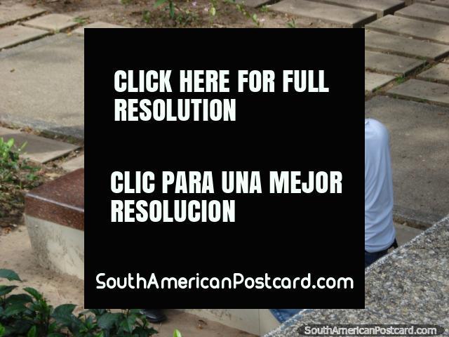 2 men play chess in Plaza Simon Bolivar in San Cristobal. (640x480px). Venezuela, South America.