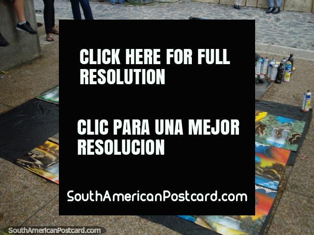 A man paints spraycan landscapes at Plaza Bolivar in Merida. (640x480px). Venezuela, South America.
