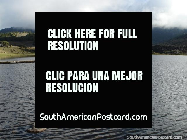 The calm waters of the beautiful lagoon near Merida - Laguna de Mucubaji. (640x480px). Venezuela, South America.