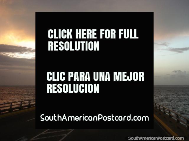 Driving on the bridge over Lake Maracaibo at dusk. (640x480px). Venezuela, South America.