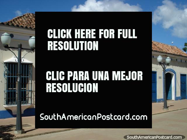 Blue and cream colored building with a tiled roof in Coro. (640x480px). Venezuela, South America.
