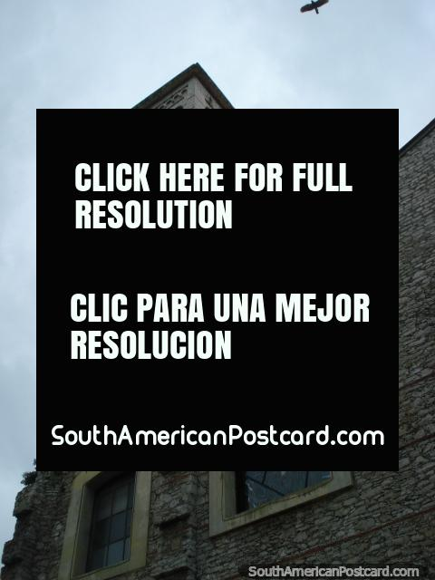 Church tower of stone, bird overhead, Puerto Cabello, Iglesia Catedral San Jose. (480x640px). Venezuela, South America.