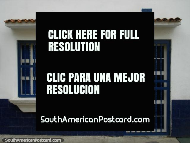 A neat and tidy white and blue front face of a house in Puerto Cabello. (640x480px). Venezuela, South America.