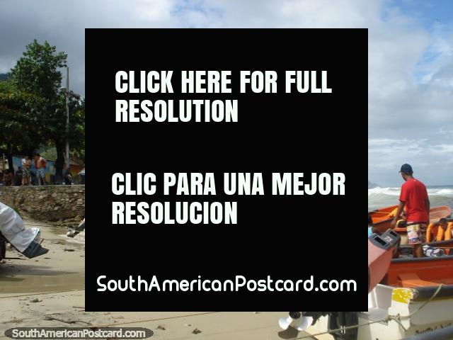 The beach and park behind in the Puerto Colombia township. (640x480px). Venezuela, South America.