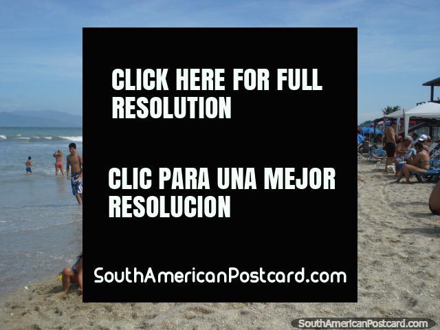 Visitors to La Restinga enjoy the sand and surf on Isla Margarita. (640x480px). Venezuela, South America.