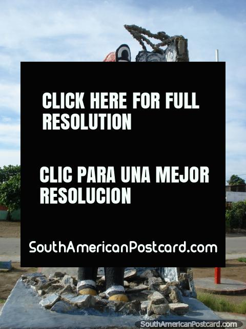 Monument to firemen in a plaza in Boca de Rio, Isla Margarita. (480x640px). Venezuela, South America.