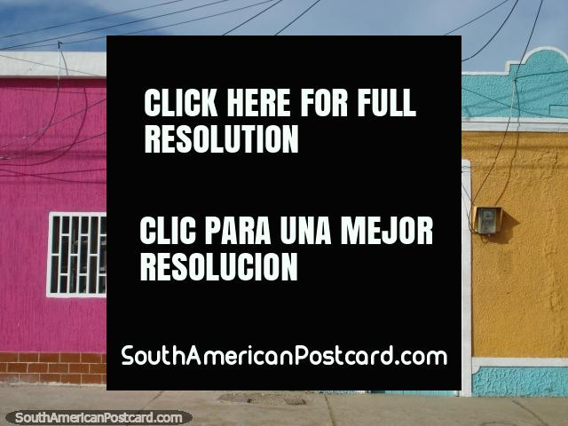 A house of bright pink on a colorful street in Boca de Rio, Isla Margarita. (640x480px). Venezuela, South America.
