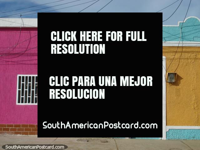 A house of bright pink on a colorful street in Boca de Rio, Isla Margarita. (640x480px). Venezuela, South America.