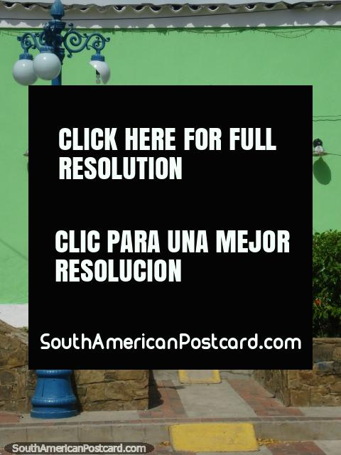 Green building and blue street lamp in Pampatar, Isla Margarita. (480x640px). Venezuela, South America.