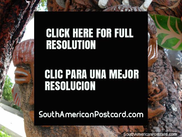 Carvings of voodoo men in a tree in Pampatar, Isla Margarita. (640x480px). Venezuela, South America.
