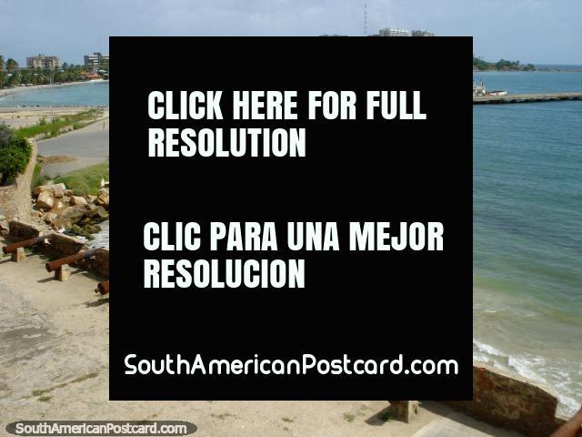 View from Castillo San Carlos de Borromeo of the cannon, city, beach, wharf and sea in Pampatar, Isla Margarita. (640x480px). Venezuela, South America.