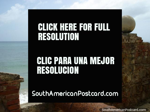 Close up cannon points to sea at castle in Pampatar, Isla Margarita. (640x480px). Venezuela, South America.