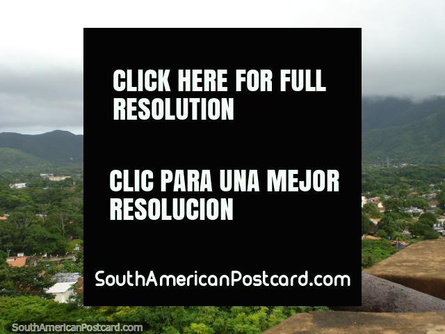 Cannon and views of La Asuncion from Castillo Santa Rosa de la Eminencia on Isla Margarita. (640x480px). Venezuela, South America.