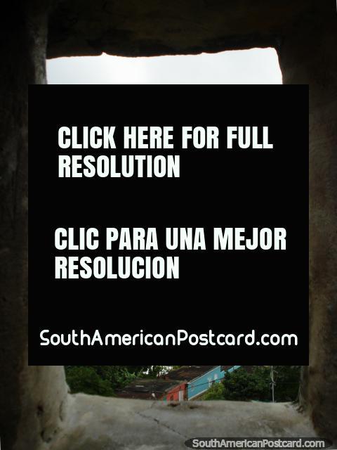 View of La Asuncion through the square fortress window. (480x640px). Venezuela, South America.