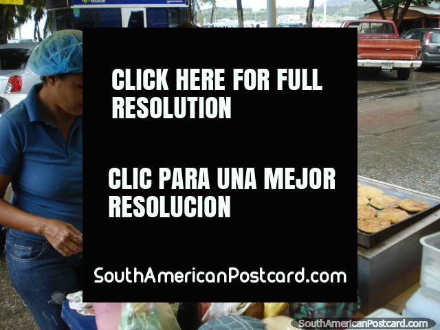 Woman making fresh arepas in the street in Juan Griego on Isla Margarita. (640x480px). Venezuela, South America.
