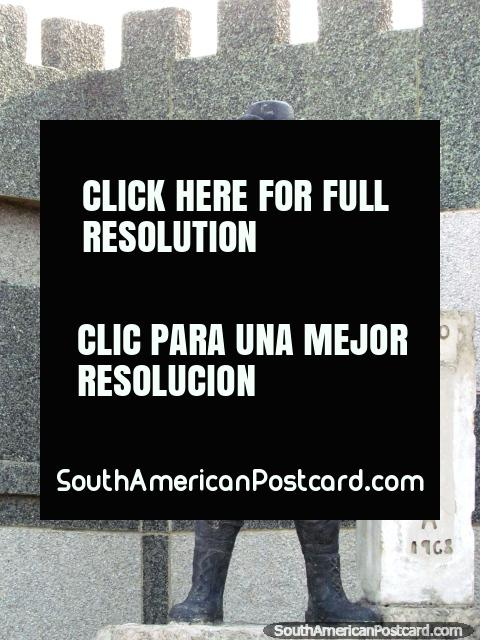 Statue, soldier looks through binoculars, outskirts of Maracaibo. (480x640px). Venezuela, South America.
