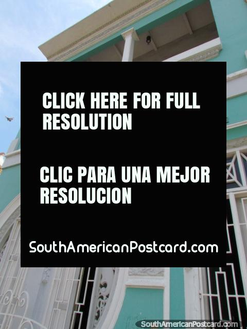 Light green house with big round window and balcony in Maracaibo. (480x640px). Venezuela, South America.