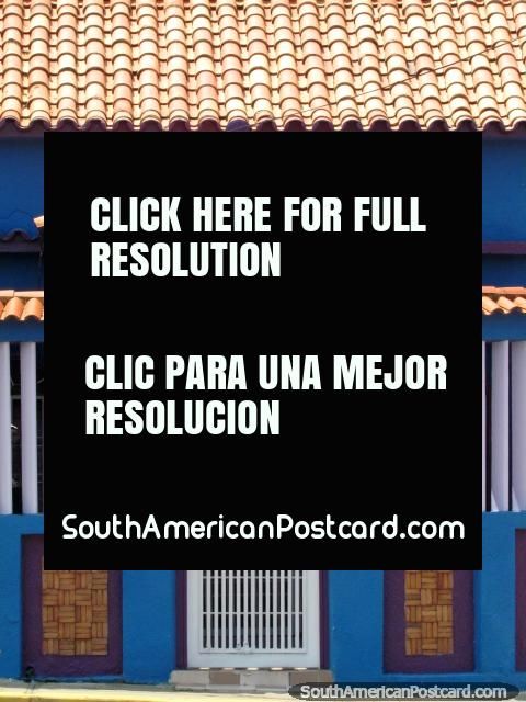 Villa Maria, nice blue house with red tiles in Maracaibo. (480x640px). Venezuela, South America.