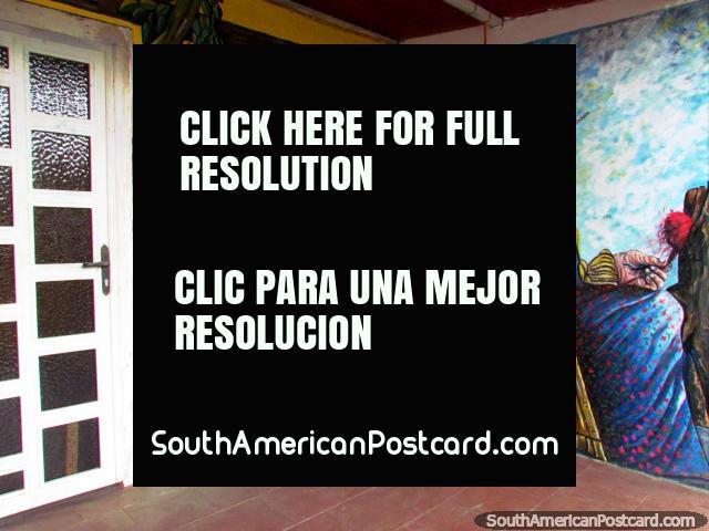 Grandmother weaves mural in El Tintorero. (640x480px). Venezuela, South America.