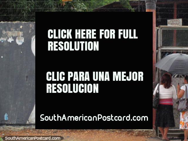 Wall mural of a man with bird on shoulder and 2 women under an umbrella, Barquisimeto. (640x480px). Venezuela, South America.