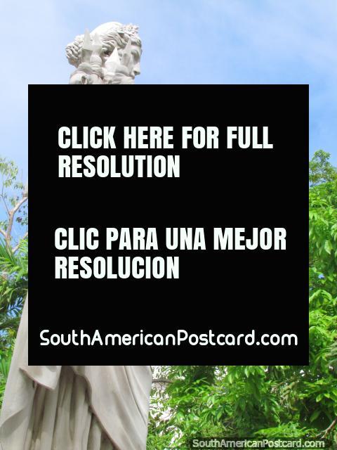 White statue and trees in Plaza Bolivar in Ciudad Bolivar. (480x640px). Venezuela, South America.