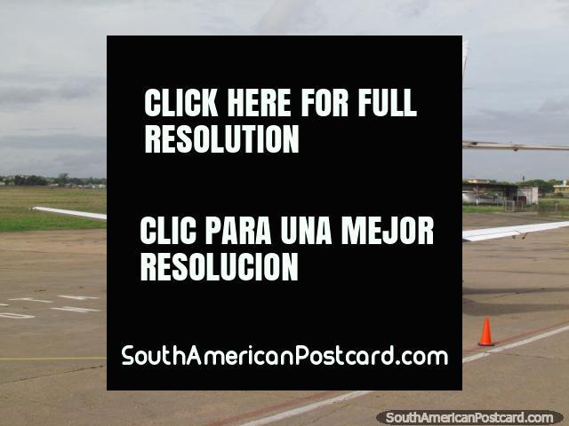 People boarding a 19 seater plane leaving Ciudad Bolivar for Canaima. (640x480px). Venezuela, South America.