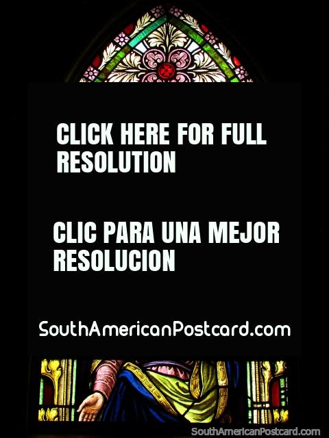 Female religious figure depicted on a stained glass window at church in Colonia Tovar. (480x640px). Venezuela, South America.