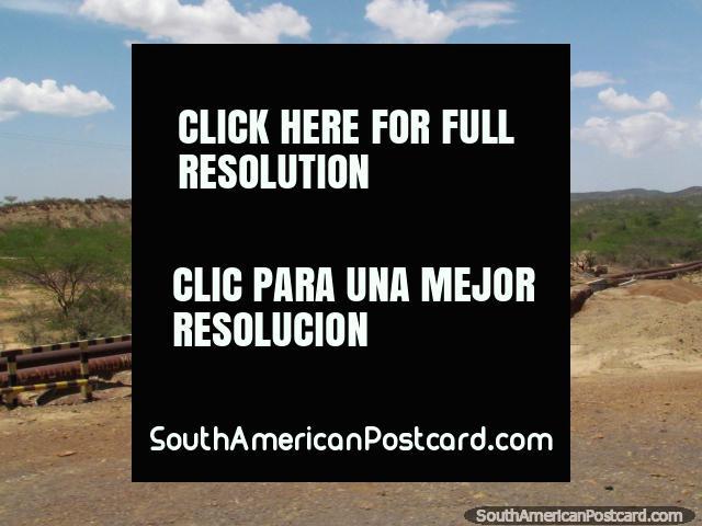 Oil pipelines scatter the terrain between Dabajuro and Coro. (640x480px). Venezuela, South America.