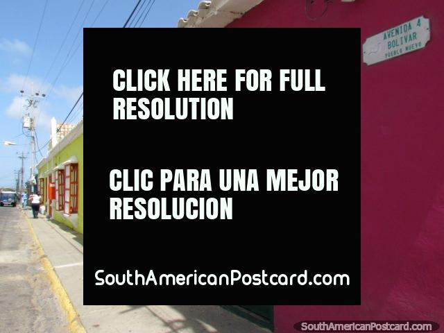 Some colorful walls, windows and doors on a street in Pueblo Nuevo. (640x480px). Venezuela, South America.