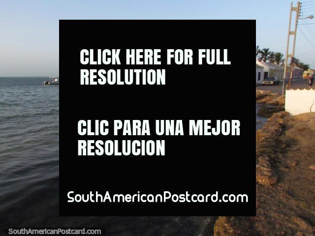 Buildings with palms around them near the north beach in Adicora. (640x480px). Venezuela, South America.