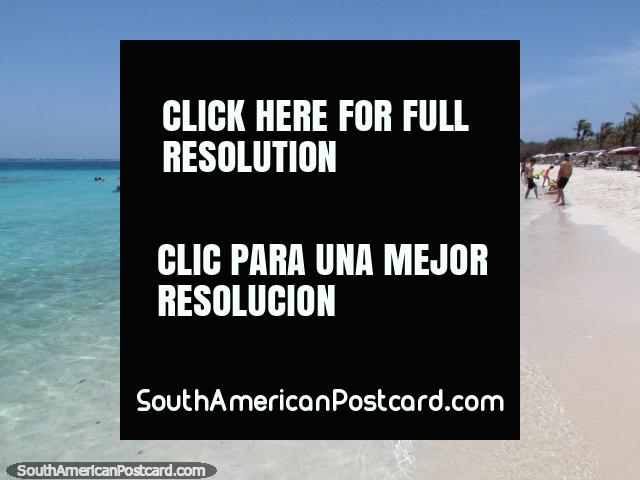 People enjoy the cool clear waters at the first beach of Cajo Sombrero at Morrocoy National Park. (640x480px). Venezuela, South America.