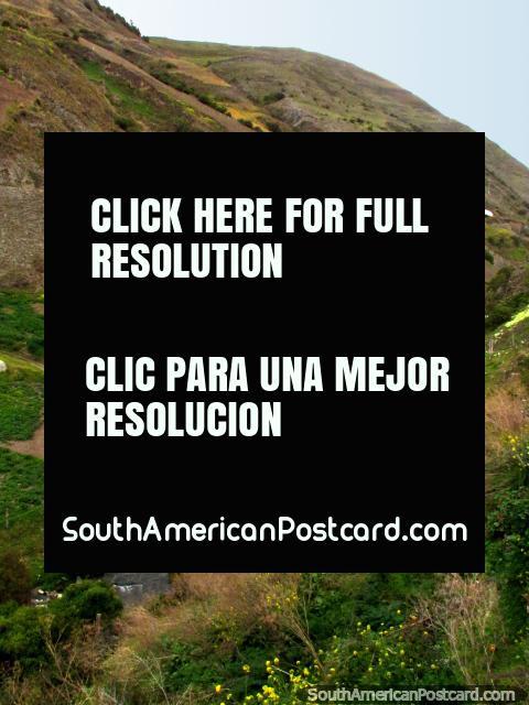 River runs down the valley in San Rafael de Mucuchies, the hills behind. (480x640px). Venezuela, South America.