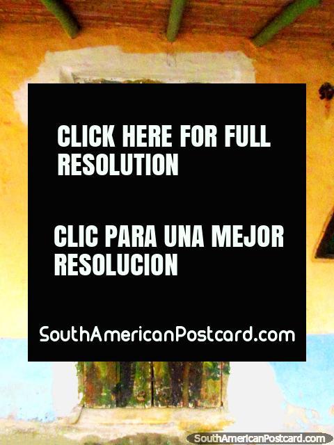 A pair of cowboys painted on a door in San Isidro de Apartaderos. (480x640px). Venezuela, South America.
