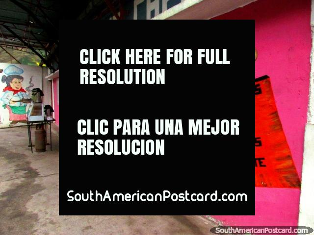 The pink restaurant and mural in the town of Biguznos/Pedregal. (640x480px). Venezuela, South America.